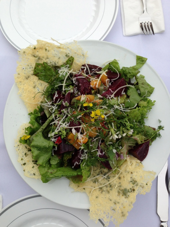 "Local greens, flowers, and beets, with parmesan ""crackers"""